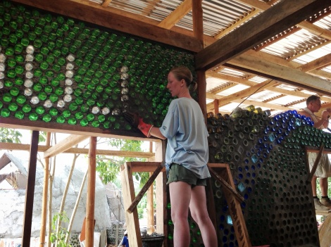 Allison working on the decorative bottle wall cleanup